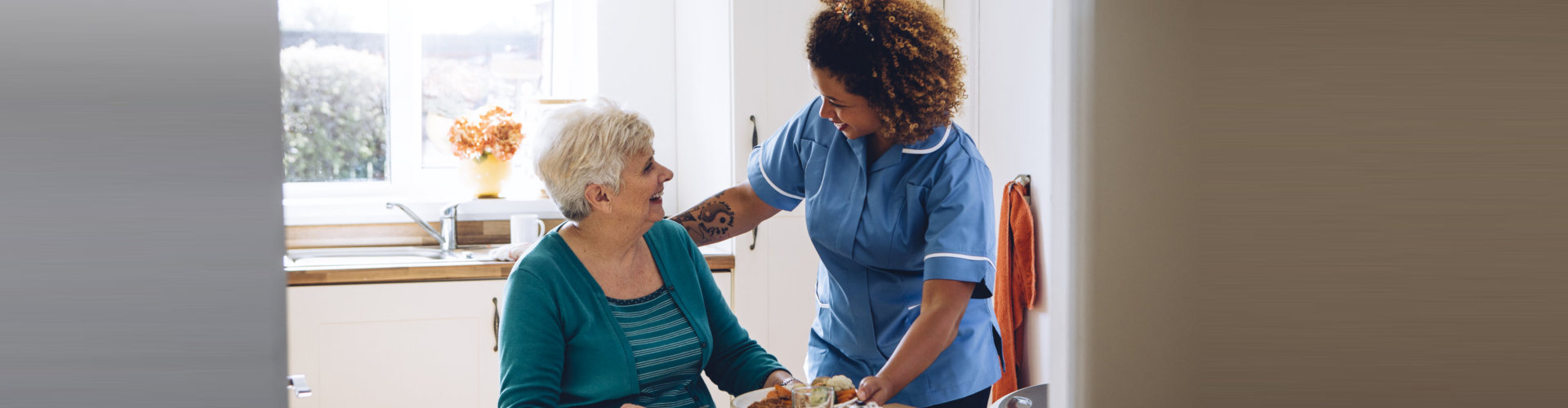caregiver serving senior woman her food